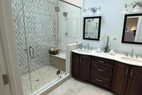 The master bathroom includes a full bath with a double vanity.