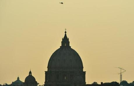 A helicopter passed by the dome of St Peter's basilica at the Vatican in Rome. Benedict boarded a helicopter this afternoon to fly to the papal summer residence.