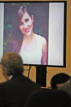 Nathaniel Fujita (right foreground) slumped over as the image of Lauren Astley was shown at his murder trial.