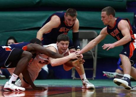 Milton Academy's Ike Ngwudo (23), Nick Bland (3), and Max Motroni (21) caused a turnover as Tabor's Jeremiah Adams (30) couldn't maintain possession in the NEPSAC playoff game at Milton.
