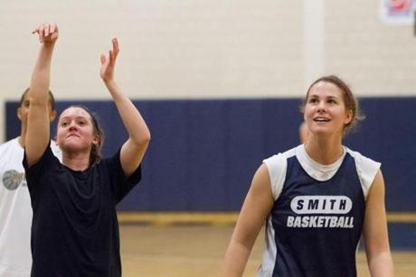 Devon Quattrocchi, left, and Rosa Drummond, two of the team's top scorers, shoot around during practice.