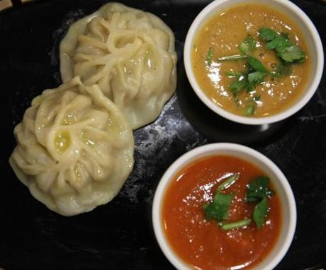 Chicken steamed momos and sauces.