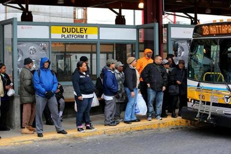 Passengers waited Friday at Dudley Square Station. A man was shot to death on a bus platform there Thursday night.