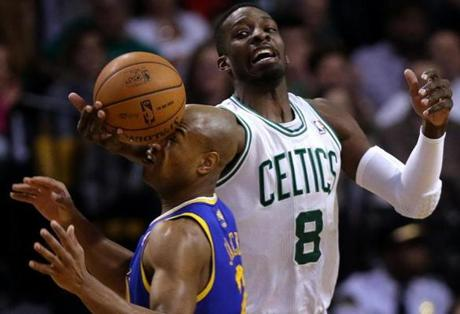 Boston Celtics power forward Jeff Green (8) knocked the ball free from Golden State Warriors point guard Jarrett Jack (2) during the third quarter at TD Garden.