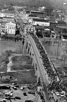 "Vice President Joe Biden and US Representative John Lewis led a group across the Pettus Bridge in Selma, Ala., to mark the 48th anniversary of the ""Bloody Sunday"" march (right), when state troopers brutally attacked civil rights advocates."
