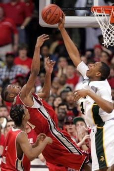 Columbus Northland's Jared Sullinger, right, blocks a shot by Cincinnati Princeton's Orlando Williams during the fourth quarter of the Division I boys Ohio state basketball championship game Saturday, March 28, 2009, in Columbus, Ohio. Columbus Northland won 60-58. (AP Photo/Paul Vernon)