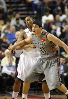 Junior National Select Team's Jared Sullinger, left, guards World Select Team's Enes Kanter, of Turkey, in the first quarter during the Nike Hoop Summit Saturday, April 10, 2010, in in Portland, Ore.(AP Photo/Rick Bowmer) Published 10-13-2010: Enes Kanter, right, and his family are said to have received more than $100,000 in salary and expenses from a Turkish team. (Rick Bowmer/Associated Press)