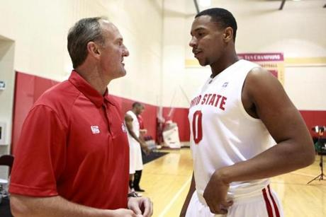 Ohio State coach Thad Matta, left, talks with freshman Jared Sullinger (0) during the NCAA college basketball squad's media day Thursday, Oct. 14, 2010, in Columbus, Ohio. (AP Photo/Terry Gilliam)