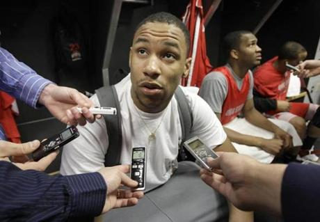 Jared Sullinger of Ohio State talks to reporters in the locker room after practice for an East Regional third round game in the NCAA college basketball tournament in Cleveland on Saturday, March 19, 2011. At right is teammate William Buford. Ohio State will face George Mason on Sunday. (AP Photo/Amy Sancetta)