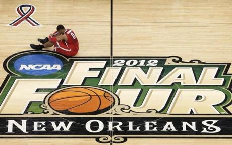 Ohio State forward Jared Sullinger sits on the court at the end of an NCAA Final Four semifinal college basketball tournament game against Kansas Saturday, March 31, 2012, in New Orleans. Kansas won 64-62. (AP Photo/David J. Phillip)