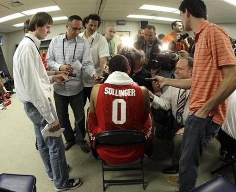 Ohio State's Jared Sullinger (0) speaks to the media in the locker room after an NCAA Final Four semifinal college basketball tournament game against Kansas Saturday, March 31, 2012, in New Orleans. Kansas won 64-62. (AP Photo/Mark Humphrey)
