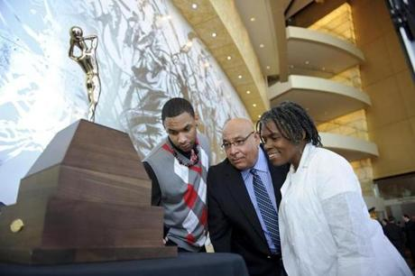 ATLANTA - MARCH 23: Jared Sullinger (left) of Northland High School in Columbus, Ohio and his parents look at his trophy for the Boy's
