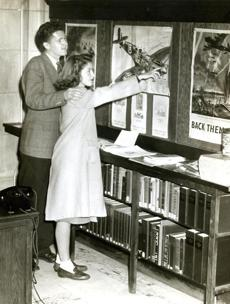 October 29, 1942:  Paul Lambert of Dorchester and Emily Scott of Hyde Park visited the War Information Center at the Boston Public Library. The Works Projects Administration (WPA) provided assistance for every library to become a War Information Center,