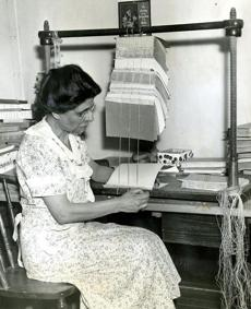 May 22, 1938: In 1937, the library rebounded 75,000 books. Library employee Nettie Bandiera is shown here preparing to do a job of hand stitching to the 1938 collection. A study by the library at this time showed that books averaged just five lendings before they came to the bindery for rebuilding.