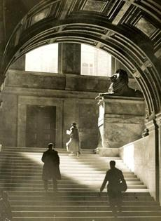 June 13, 1926: The play of light on the marble of the grand staircase lead one up to the twin lions on pedestals at the turn of the stairs. The lions are made from unpolished Siena marble by sculptor, Louis Saint-Gaudens. They are memorials to the Second and Twentieth Massachusetts Civil War infantry regiments.
