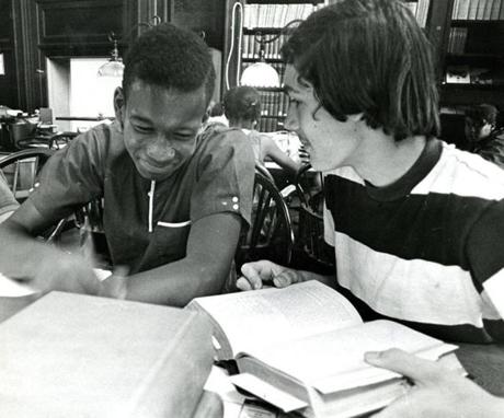 July 16, 1968:  Ronald Hobson 14, left, of Dorchester and Nathaniel Hickler, 14 of Wellesley shared a laugh during a visit to the Boston Public Library as part of the Wellesley Summer Program.