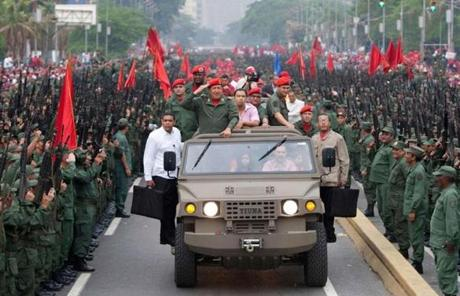 Chavez saluted militia members at a 2010 ceremony in Caracas to mark the eighth anniversary of his return to power after a brief coup.