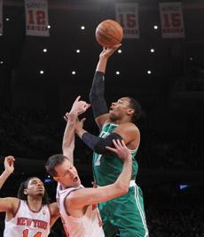 NEW YORK, NY - JANUARY 07: Jared Sullinger #7 of the Boston Celtics is fouled by Steve Novak #16 of the New York Knicks in the first quarter at Madison Square Garden on January 7, 2013 in New York City. NOTE TO USER: User expressly acknowledges and agrees that, by downloading and/or using this photograph, user is consenting to the terms and conditions of the Getty Images License Agreement. (Photo by Bruce Bennett/Getty Images)
