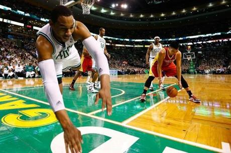 BOSTON, MA - JANUARY 11: Jared Sullinger #7 of the Boston Celtics dives out of bounds after being fouled in front of Jeremy Lin #7 of the Houston Rockets during the game on January 11, 2013 at TD Garden in Boston, Massachusetts. NOTE TO USER: User expressly acknowledges and agrees that, by downloading and or using this photograph, User is consenting to the terms and conditions of the Getty Images License Agreement. (Photo by Jared Wickerham/Getty Images)