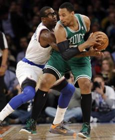 New York Knicks forward Amare Stoudemire (1) defends against Boston Celtics forward Jared Sullinger (7) in the first half of their NBA basketball game at Madison Square Garden in New York, Monday, Jan. 7, 2013. (AP Photo/Kathy Willens)