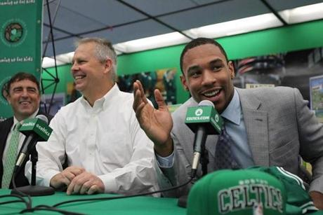 Allston, Ma., 07/02/12, The Boston Celtics introduced their new draft picks at the Jackson Mann/Horace Mann Complex in Allston, MA, just before they unveil a renovated library and multipurpose room that was donated by the Boston Celtics Shamrock Foundation. Very comfortable in front of the media: Jared Sullinger, cq. On left is co-owner Wyc Grousbeck, in middle is President Danny Ainge. Section: Sports Suzanne Kreiter/Globe staff