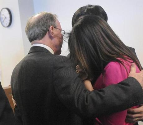 Malcolm Astley embraced Tomo Fujita and his wife, Beth Mattingly-Fujita, on Thursday after the verdict.