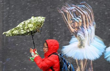 Milton,Quincy,Boston, MA--3/7/2013--A woman's umbrella mimics the movement of dancers' arms, as she walks at Tremont and Stuart streets. An early-March snow storm hits the Boston area, on Thursday, March 7, 2013, Photos by Pat Greenhouse/Globe Staff Topic: 08storm Reporter: XXX