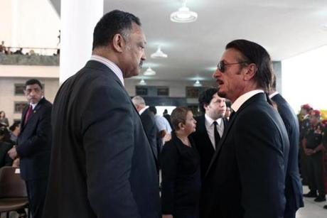 Reverend Jesse Jackson (left) talked with actor and filmmaker Sean Penn at the funeral of Venezuelan President Hugo Chavez.