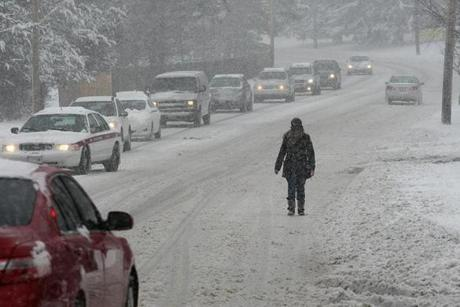 More winter misery made a long commute for some. Sidewalks were not an option on Washington Street, so pedestrians shared the road with cars.