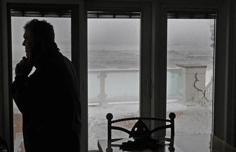 Plum Island homeowner Bob Connor stood in his home during the storm.