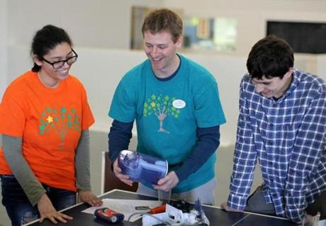 Left to right: Brianna Callanan with instructor Rob Shamitz and Adam Koropey in the science/ engineering workshop.