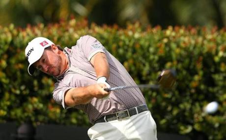 Graeme McDowell shows the form that brought him a birdie on the sixth hole of the Blue Monster in Doral, Fla.