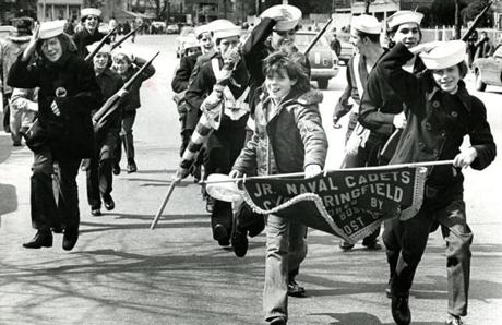 March 17, 1974: Junior Naval Cadets hurried to finish the parade while still managing to hold on to their hats. Wind gusts of more than 40 mph on the parade route made that a difficult task