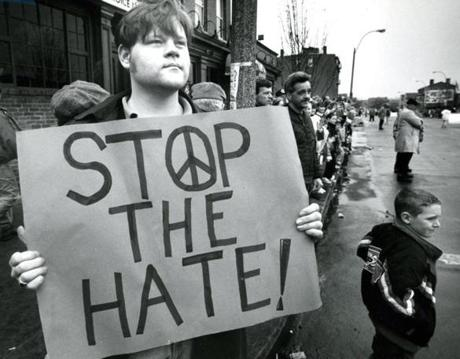 March 28 1993 / fromthearchive / Globe photo by Evan Richman / Snow had postponed the St. Patrick's Day Parade for two weeks. In their second court-backed appearance in the South Boston parade, gay marchers were met with some obscenities but also drew cheers. Supporter Brandon Krapes holds a placard along the route.