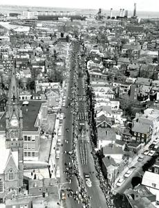 March 17, 1965: Parade marchers 10,000-strong filled Dorchester St. in South Boston as they moved toward Broadway (top of photo) under sunny skies. The parade in South Boston originated as a parade to celebrate the 125th anniversary of the evacuation of Boston and first took place on March 18, 1901