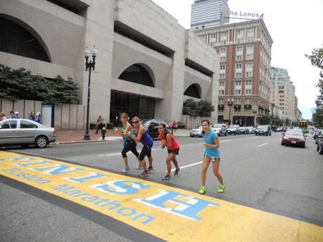 Runners imagined having finished the Boston Marathon on a City Running Tours outing.
