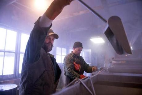 Adam Parke, right, and Todd Scelza, left, pour off and test the first maple syrup of the season.
