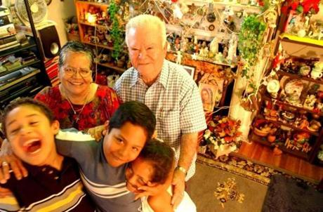 July 24, 2003: Leonor and Salvador Silva, long-time residents of the Kinnesaw apartments in Washington, D.C.,   with their grandchildren Albert Millard, 8 (left), Gabriel Leonzo, (center) 9, and his sister Alejandra Leonzo, 6. This is building is now known as the New Renaissance apartments because of the repairs that have gone to its upgrading.