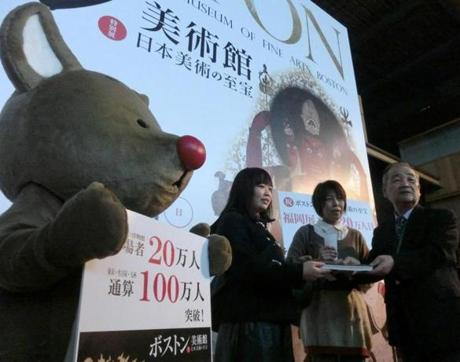 Akane Kokubo (center) was the millionth visitor to