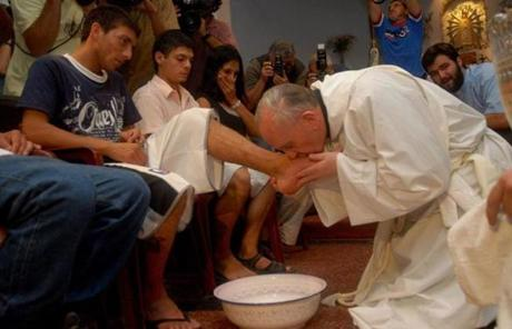Cardinal Jorge Bergoglio is seen with poor people and drug addicts in Buenos Aires during the Holy Thursday celebration on March 20, 2008.