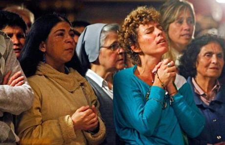 Roman Catholic faithful prayed during the first Mass to celebrate the election of Pope Francis, in the Metropolitan Cathedral in Buenos Aires.