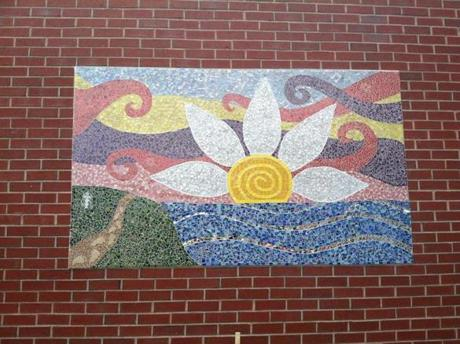 A mosaic at Wayland High School was created in honor of Lauren Astley, with symbols of her life.