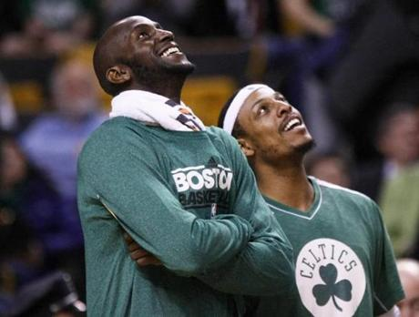 Celtics forwards Kevin Garnett, left, and Paul Pierce watched the time on the Jumbotron as both were able to get some rest due to a blowout win over the Toronto Raptors at the TD Garden.