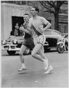 PHOTO COPYRIGHT-BOSTON ATHLETIC ASSC. Joe Smith, passes Lou Gregory, left, to take lead just before Cleveland Circle, April 20th 1942 Marathon. -- Library Tag 04122002 Marathon 02 -- Marathonhistory