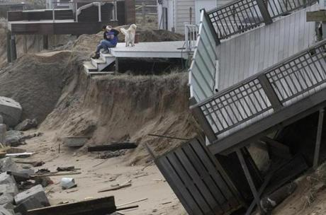 Homeowners embraced on their back porch on Plum Island.