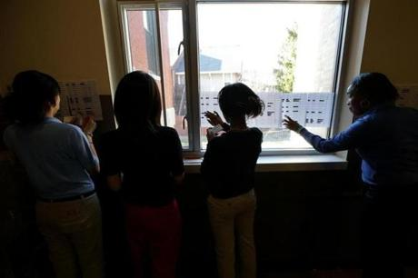 Volunteers at City on a Hill charter school posted lottery results after a drawing.