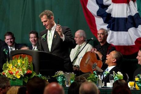 Senator Scott Brown presented Governor Deval Patrick with a phone that stored leaders at Fidelity on speed dial at the 2011 event.