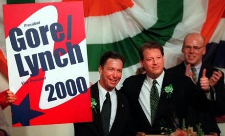 State Senator Stephen Lynch and Vice President Al Gore hold up a mock campaign sign during the 1998 St. Patrick's Day Breakfast.