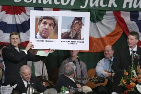 Senator Jack Hart (left) held up a poster of Senator John Kerry and Kentucky Derby winner Barbaro, with commentary by treasurer Timothy Cahill (right) during the 2007 event. Senator Joseph Biden laughed at lower left.