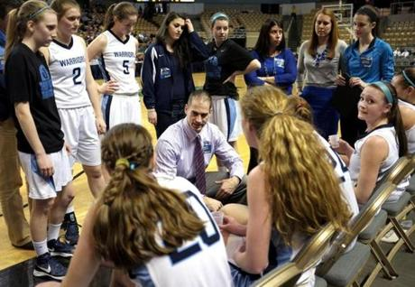 Medfield head basketball coach Mark Nickerson talks to his players in a timeout during the Div. 2 Girl's State Basketball Finals against Nashoba at the DCU Center in Worcester.